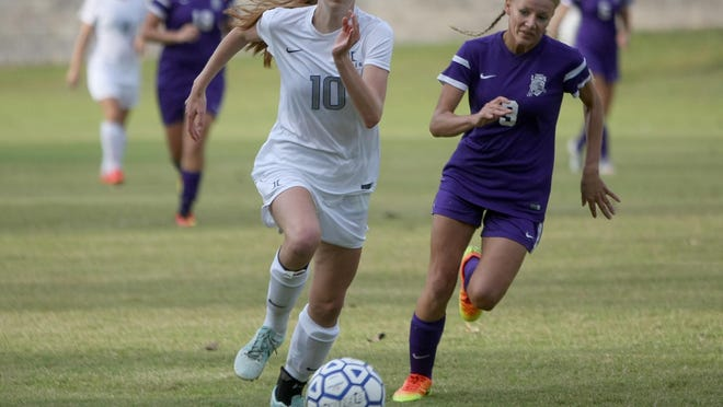 Jackson Christian's Mary Claire Swaim (10) and Trinity Christian Academy's Jenna Layne (3) pursue the ball at Jackson Christian on Monday.