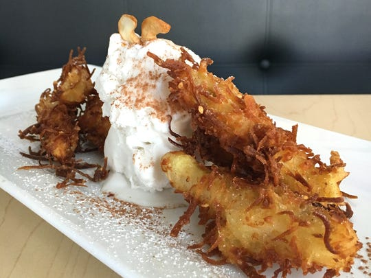 Desserts at Prawn & Basil in Thousand Oaks include young-coconut ice cream with fried bananas coated in shredded coconut.