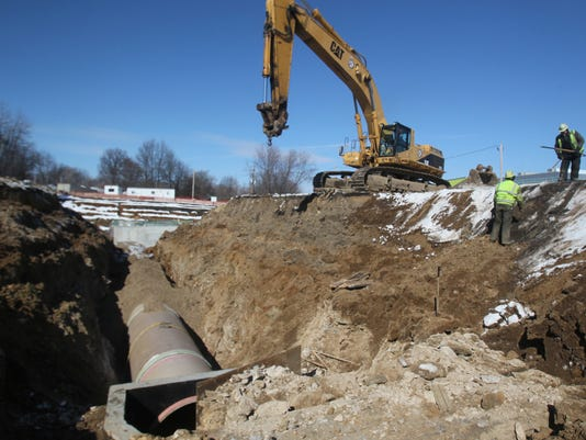 Akron considers starting own construction company for sewer work
