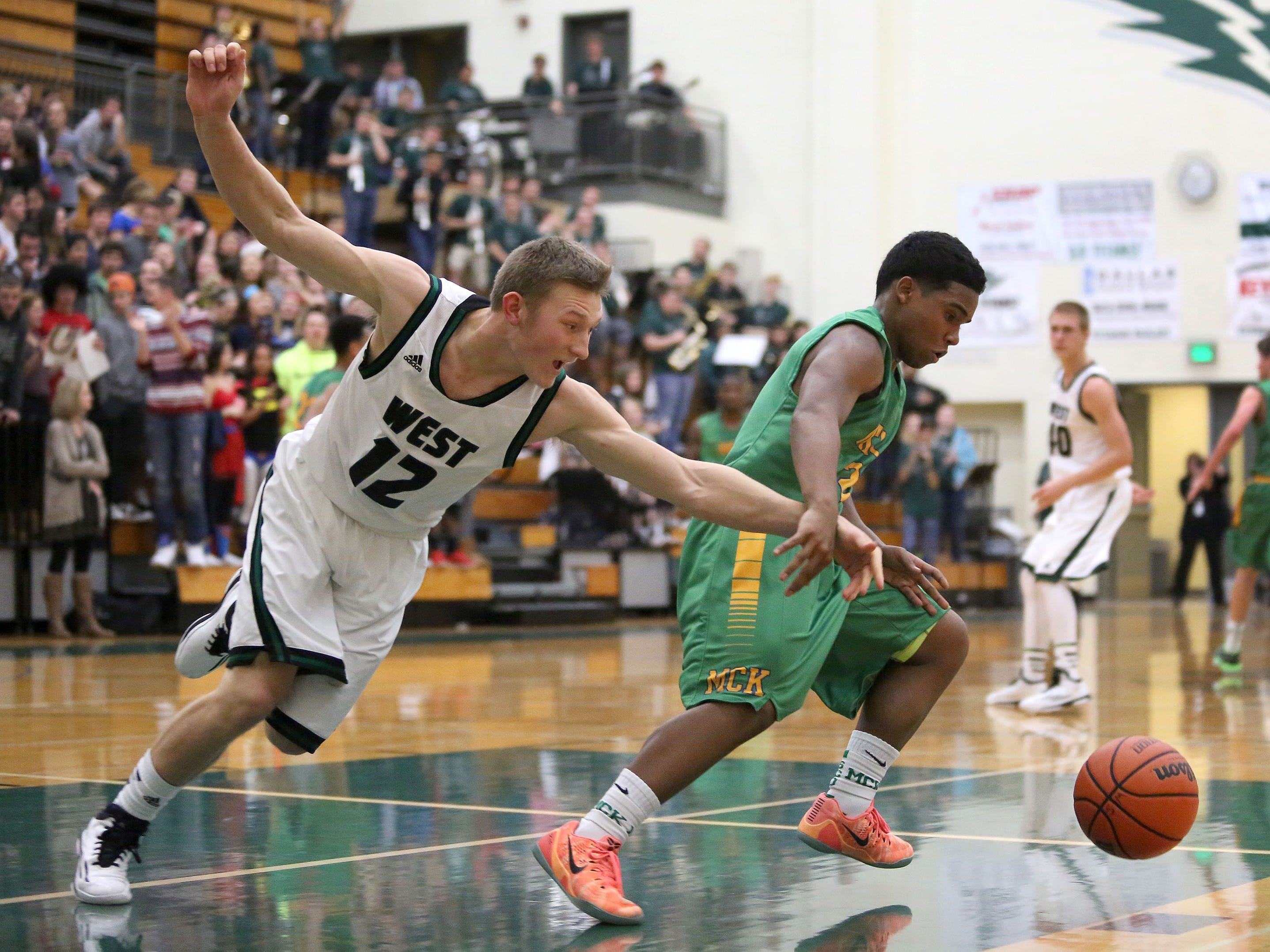 West Salem's Andy Armstrong lunges for the ball as McKay's Demaris Bailey drives down the court during their Greater Valley Conference game on Friday.