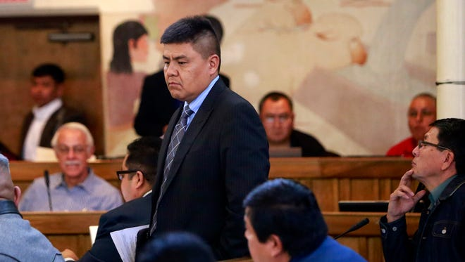 Delegate Jonathan Hale returns to his seat after the Navajo Nation Council passed his bill during the winter session on Tuesday in Window Rock, Ariz.