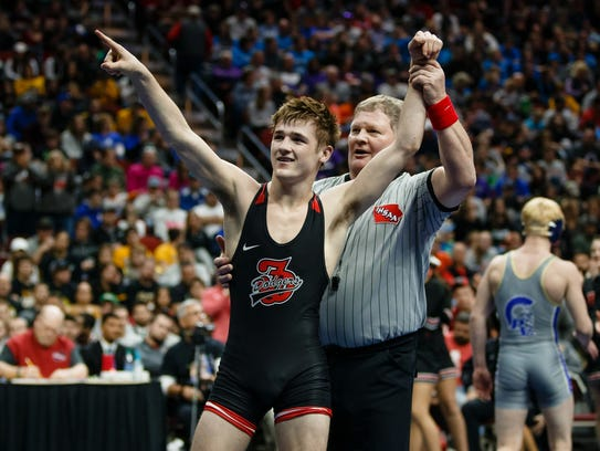 Drew Bennett of Fort Dodge celebrates a 9-4 win over Pleasant Valley's Eli Loyd during their class 3A 132 pound championship match at Wells Fargo Arena on Saturday, Feb. 17, 2018, in Des Moines.