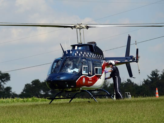 Crew members prepare to take off with a patient who deputies say was struck by a vehicle Thursday, Sept. 3, 2014.