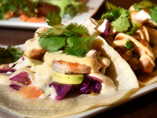 Shrimp tacos on corn tortillas, cilantro lime slaw, sliced avocado, diced tomatoes, old bay seasoned shrimp and roasted garlic aioli, shown Friday, March 17, at The Pickled Loon.