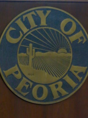 A City of Peoria decorative piece at a Peoria Council Chamber.