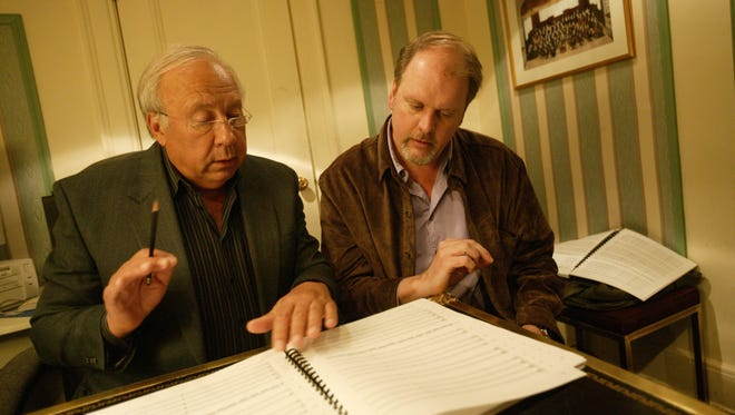 Detroit Symphony Orchestra music director emeritus Neeme Jarvi and former DSO composer-in-residence Michael Daugherty discuss one of the composer's scores in 2003 at Orchestra Hall.