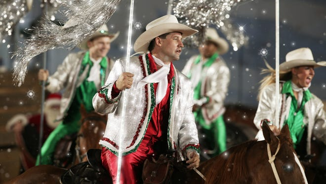 Dixie Stampede's holiday show includes horseback riders.