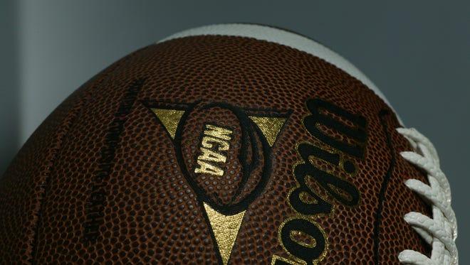 Photograph of a Wilson NCAA logo college football.