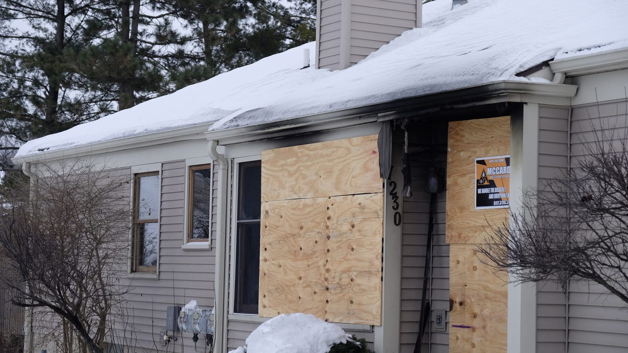 Four people, including an Eaton County Sheriff's deputy, were injured in a condo fire on the 7000 block of Creekside Drive in Delta Township on Tuesday, Dec. 20, 2016.