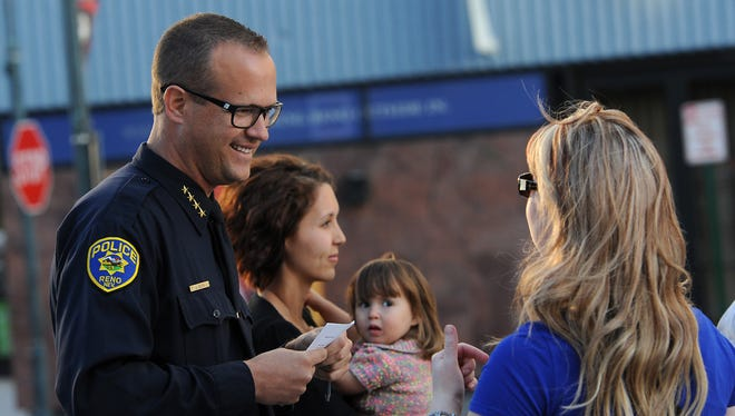 Interim Reno Police Chief Jason Soto speaks to people gathered during a ceremony to honor fallen police officers under the Reno Arch on May 1, 2015.