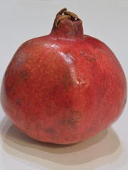 Pomegranates contain hundreds of red seeds called arils.