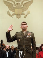 Lt. Col. Oliver North is sworn in  Dec. 9,1986 before the House Foreign Affairs Committee hearing in Washington, D.C.