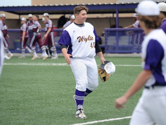 Wylie pitcher Blake Smith (45) smiles coming off the