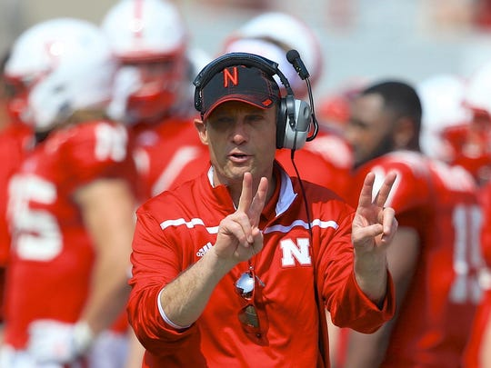 Mike Riley coaches in the Red-White spring game in April with nearly 77,000 fans in attendance.