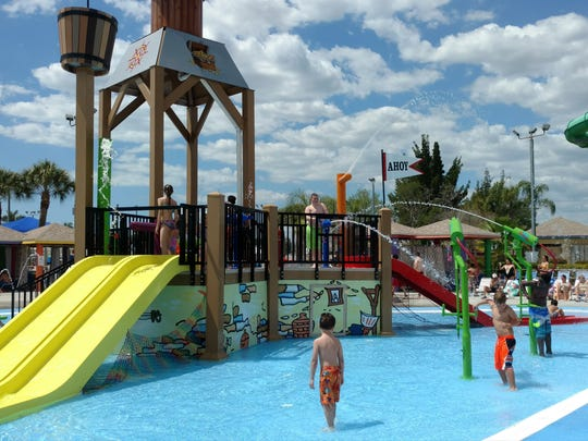 Kids shoot water at each other at the Pirate's Cove at Sun Splash Family Waterpark.