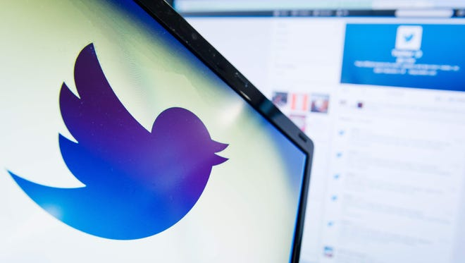 This file photo taken on September 11, 2013 shows the logo of social networking website 'Twitter'  displayed on a computer screen in London. Twitter was one of the website impacted by Friday's attacks.