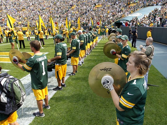 The Tundra Line welcomes the Green Bay Packers on the field during the home opener against the Detroit Lions on Sept. 25 at Lambeau Field.