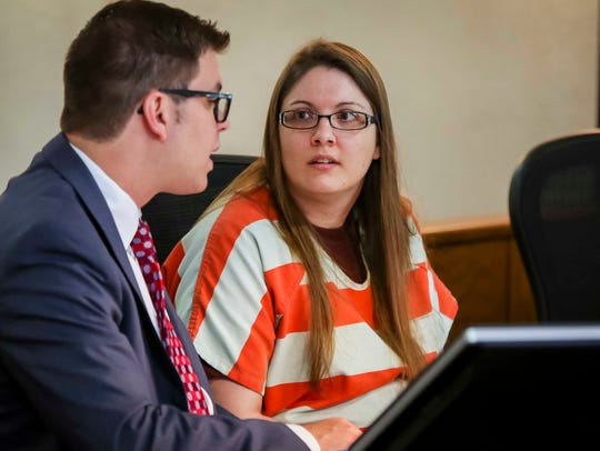 Nicole Finn talks to her lawyers in a Polk County Courthouse courtroom Wednesday, May 31, 2017, in Des Moines.
