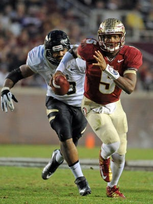Florida State Seminoles quarterback Jameis Winston (5) runs away from pressure by Idaho Vandals defensive end Maxx Forde (40) during the second half at Doak Campbell Stadium.