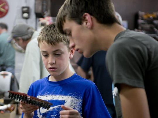 Brothers Joshua Holbrook, 14, of Marion, left, and