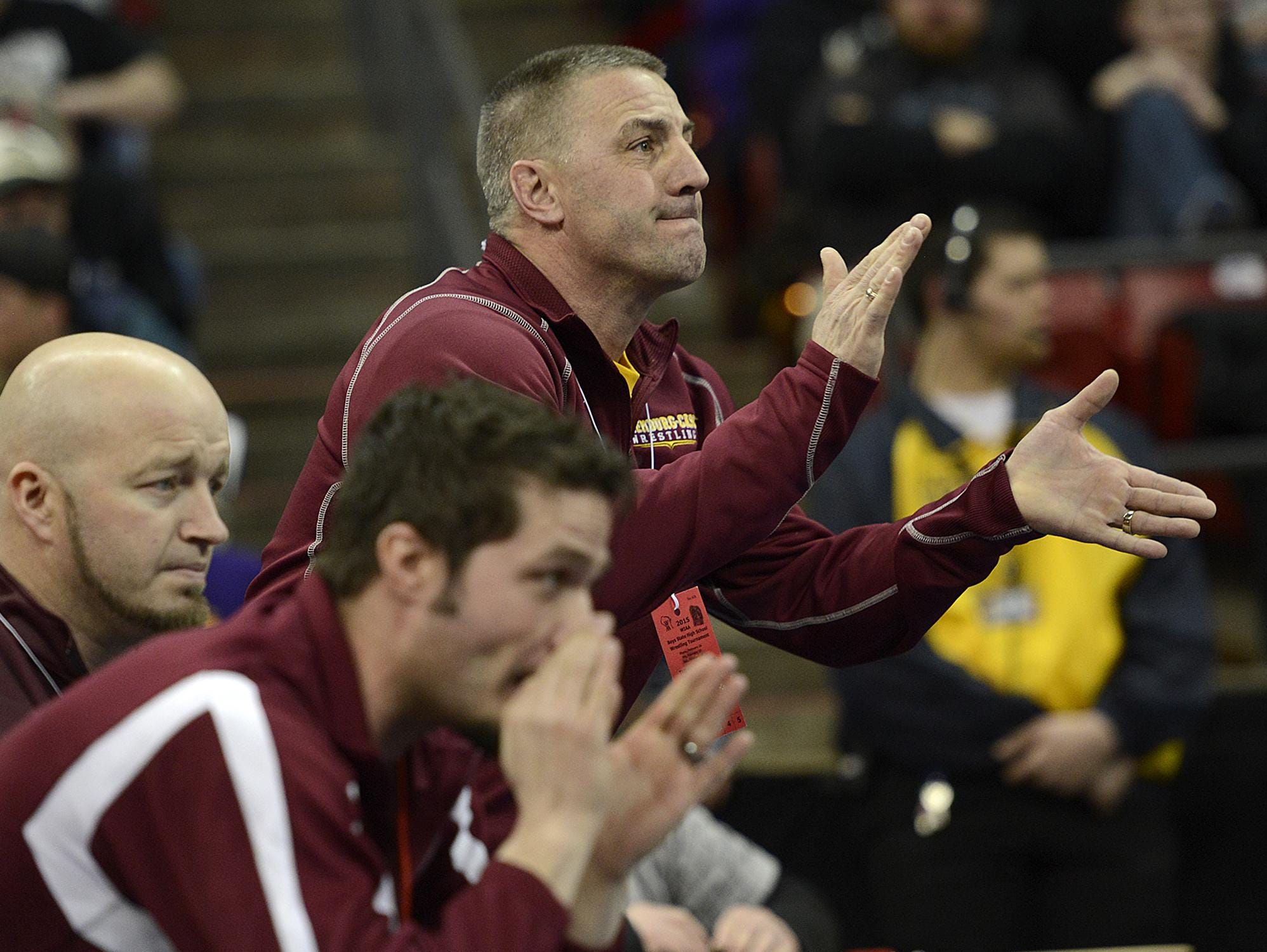 L-C coach Bob Berceau cheers on his son Mason during his match against Cuba City's Josh Donar in their 138-pound Division 2 semifinal at the WIAA individual state wrestling tournament in February.
