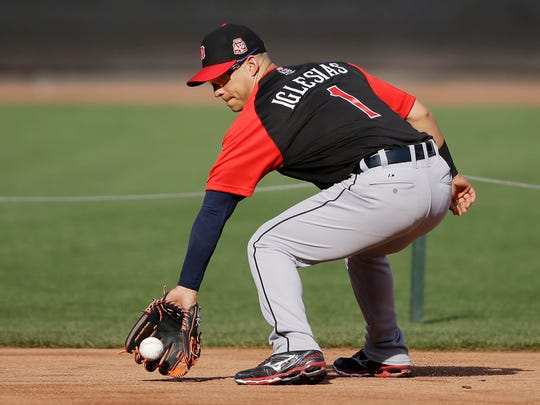 American League's Jose Iglesias, of the Detroit Tigers, fields a ground ball during batting practice for the MLB All-Star baseball game, Monday, July 13, 2015, in Cincinnati.