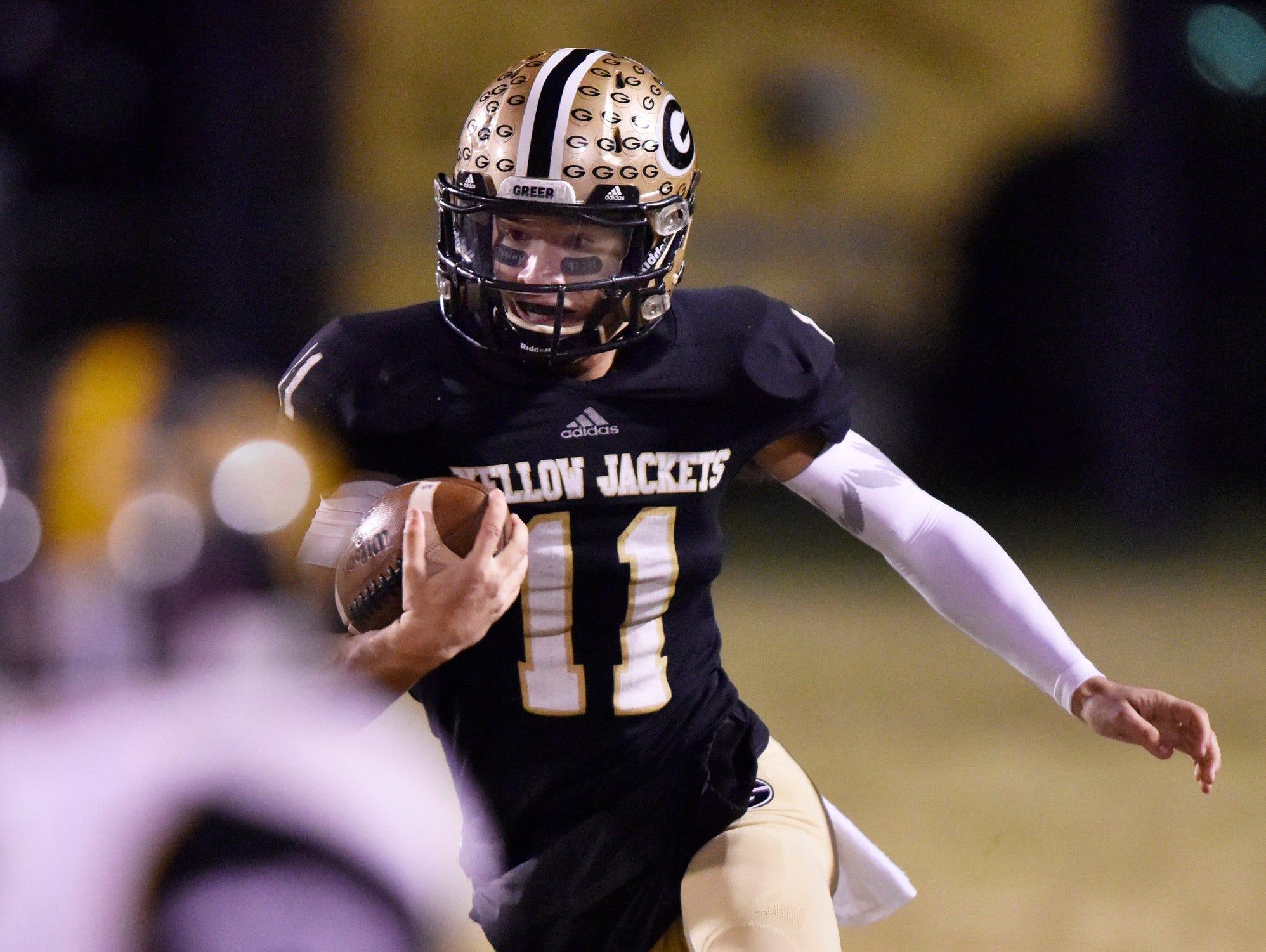 Greer quarterback Mario Cusano (11) rushes against Union County.