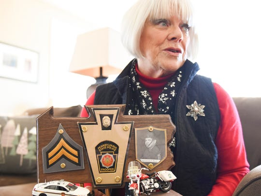 Recently retired 101st state representative Mauree Gingrich holds up a memento retired Pennsylvania State Police Cpl. Bob Caruso made for her to honor her father Cpl. Jerome Boyd as she talked about her political career at her home in Hershey on Tuesday, Dec. 20, 2016.