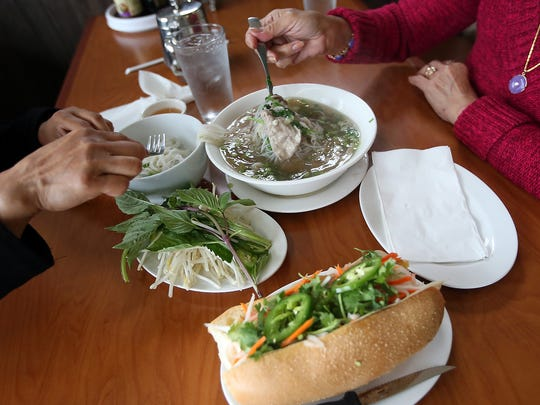 Diners enjoy pho and bahn mi at 4 Sisters Pho in East Bremerton on Saturday.