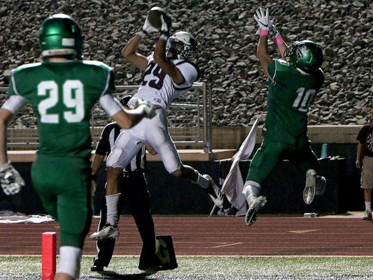 Vernon's Anthony Garza (29) intercepts a pass against Iowa Park last year.