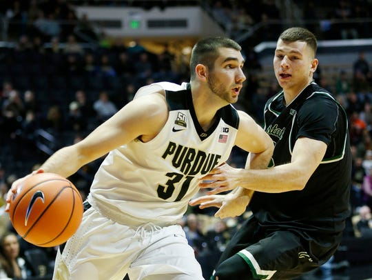 Dakota Mathias gets around Patrick Szpir of Chicago State during Purdue's 111-42 victory.
