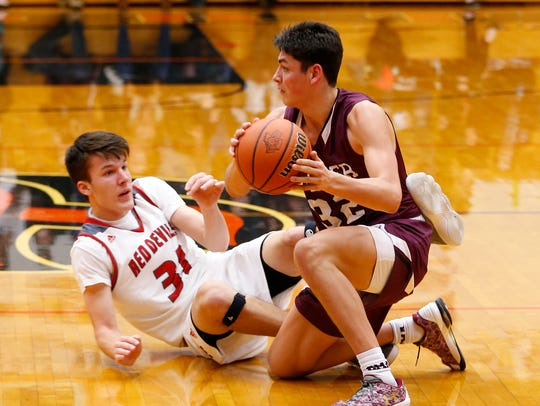 Trey Galloway of Culver Academy steals the ball from Matt Krause of West Lafayette in the basketball regional championship Saturday, March 10, 2018, in LaPorte, Indiana.
