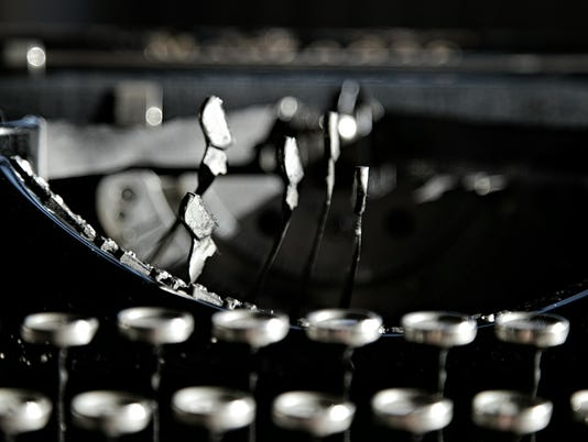 Closeup photo on black vintage typewriter.