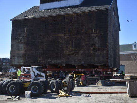 The granary is getting its wheels to move to new home. Workers continue to attach wheels to a steel frame Monday, March 19, 2018, in preparation for moving the granary across the Maple-Oregon Bridge.