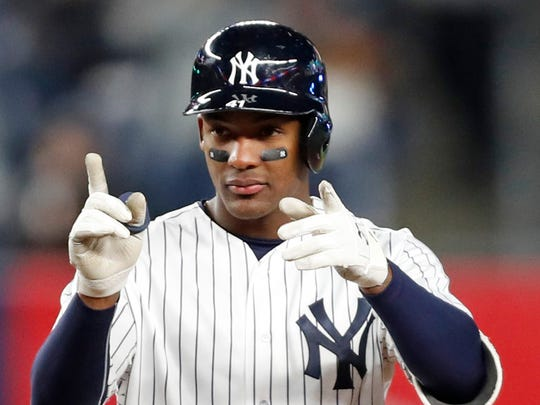 New York Yankees Miguel Andujar (41) gestures toward the dugout after hitting a double in the sixth inning.