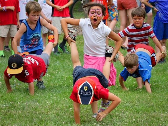 Izdihar Moola rolls her brother Zuhayr in a wheelbarrow race during the Elm Grove 4th of July Celebration at Elm Grove Village Park in 2016. Elm Grove's 2019 July Fourth Family Fun Fest is packed with activities from 8:30 a.m. to 10 p.m. July 4.