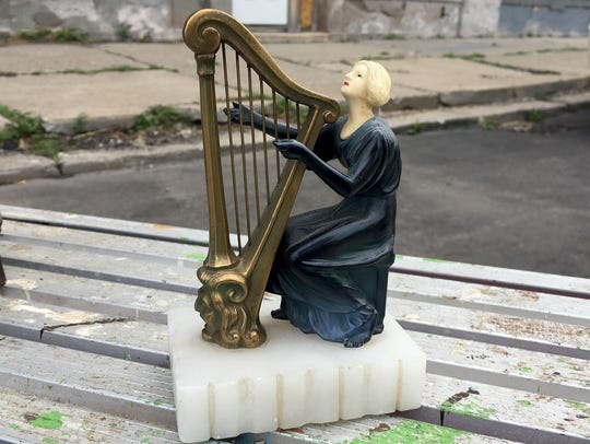 A harp figurine with a marble base that was stolen