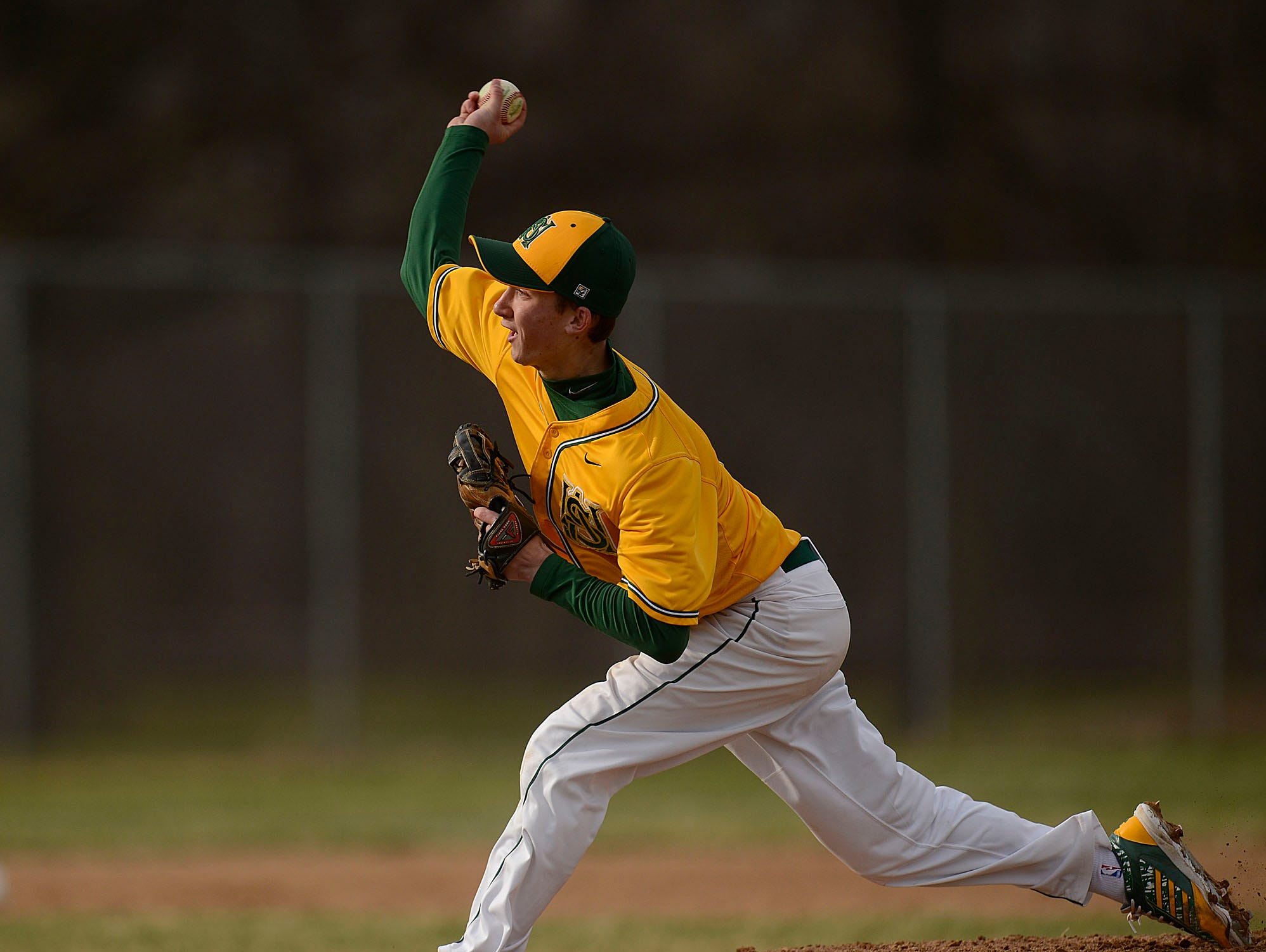 Ashwaubenon pitcher Turner Wittig (3) gets ready to fire a pitch during Tuesday's baseball game against De Pere at Ashwaubomay Park in Ashwaubenon.