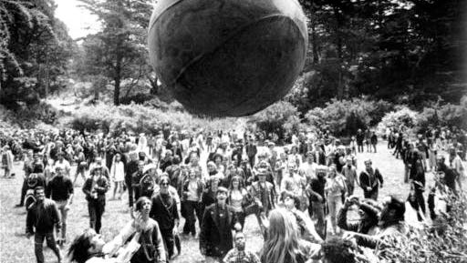 "FILE - In this June 21, 1967, file photo, a crowd of hippies keep a large ball, painted to represent a world globe, in the air during a gathering at Golden Gate Park in San Francisco, to celebrate the summer solstice on June 21, day one of ""Summer of Love."" City officials have rejected a permit for a planned free concert intended to mark the 50th anniversary of the famed Summer of Love in Golden Gate Park that had been planned for June 2017."