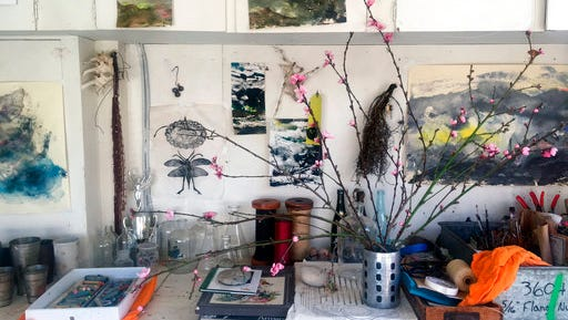 This March 7, 2017 photo provided by artist Louesa Roebuck shows her work studio in Ojai, Calif. Some of her monotype studies are seen. A few pieces by friends and creative growth artist also adorn the studio along with the peach blossoms.