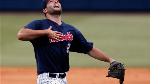 Ole Miss pitcher Sam Smith (29) calls for a second inning Washington pop fly in the second inning of an NCAA college baseball regional tournament championship game in Oxford, Miss., Monday, June 2, 2014. (AP Photo/Rogelio V. Solis)