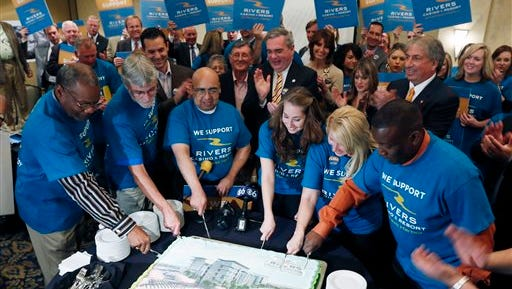 Supporters of the proposed Rivers Casino and Resort at Mohawk Harbor in Schenectady, N.Y., cut a cake during a news conference as a public meeting on casinos was being held in a nearby conference room, on Monday in Albany.