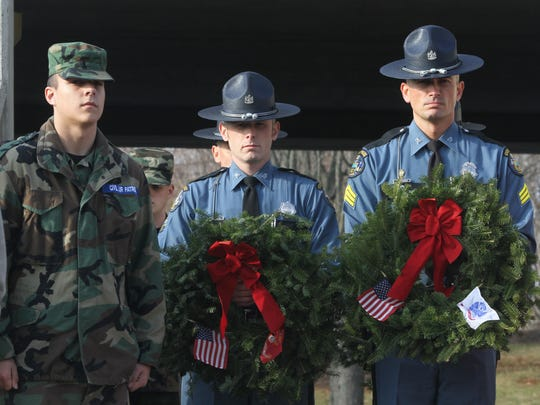 Maine State Police present wreaths during the Wreath Laying Ceremony presented by Wreaths Across America at the New Jersey Vietnam Veterans' Memorial in Holmdel, NJ Wednesday December 9, 2015.