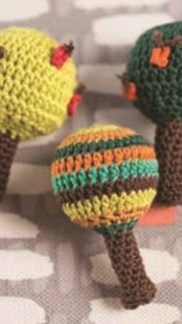 A pattern for these rattles is featured in my In Stitches