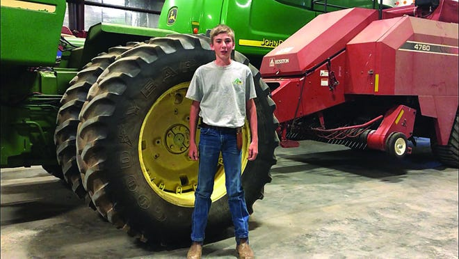 Ian Dunn of St. John, Kansas is at home in the machine shed, where he likely came up with an idea to bale straw for others. His entrepreneurial entry in a virtual contest won him $250 in prize money. More than 140 youth across Kansas entered the 2020 competition.
