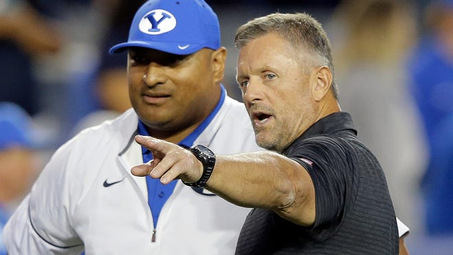 BYU coach Kalani Sitake, left, and Utah coach Kyle Whittingham are among those who will have to figure out a different strategy after the implementation of a new kickoff rule.