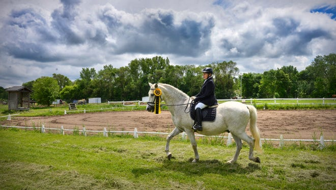 Sara Magee, 75, rides her horse, Lar Halcon, 26, Tuesday, May 31, 2016, at Mississippi View Farm in rural Sauk Rapids. Magee will become the third Minnesota member of the national dressage Century Club (where horse and rider ages add up to 100 or more) on June 11.