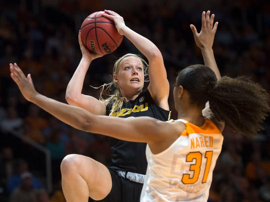 Missouri's Sophie Cunningham (3) takes a shot while defended by Tennessee's Jaime Nared (31) during a game between Missouri and Tennessee in Thompson-Boling arena Thursday, Feb. 9, 2017. Tennessee overtook Missouri in the fourth quarter, 77-66.