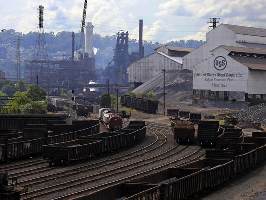 This 2018 file photo shows US Steel in Braddock, Pa. U.S. Steel Corp. will restart construction on an idled manufacturing facility in Alabama, and it gave some of the credit to President Donald Trump's trade policies in an announcement Monday.