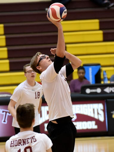Licking Heights' Tanner Werling spikes the ball during